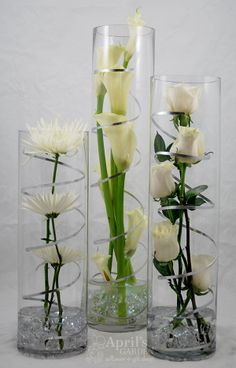 For a Modern Party. Spider mums, Calla Lilies, Roses. LED Lights are in the Pebbles at the bottom of the vases Flowers by April's Garden http://www.durangoflorist.com/
