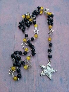 Rosary Style Star Necklace - Black & Yellow - star charm - silver star - long necklace - women's necklace - beaded necklace - rosary jewelry by Blackrose37 on Etsy