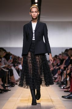 Maria Grazia Chiuri, formerly the designer for Valentino, debuts her first collection for Dior.