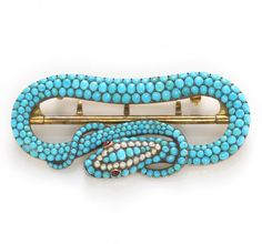 A silver, gold, turquoise and seed-pearl belt buckle, c.1860, with later-period brooch fitting, in the form of an entwined snake, symbol of eternity.