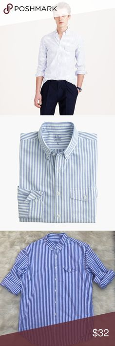 """JCREW Men's Oxford Cloth Lightweight Buttondown JCREW Men's Tall lightweight vintage oxford cloth shirt in periwinkle stripe  Size Large Tall Classic fit; this shirt is 2"""" longer in the body and sleeves.  There's nothing quite like a well-worn Oxford. Not only is it comfortable, it's the perfect way to nail the """"I have a yacht"""" look. This one is made in a lightweight fabric with a looser weave that works particularly well during summertime heat waves.  100% Cotton oxford. Button-down collar…"""