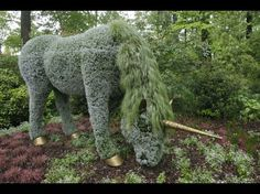 A grazing unicorn is among the sculptures created from thousands of groomed annuals growing within an invisible metal armature.  This is one of several topiary creations loaned to the Atlanta Botanical Garden from Montreal's MosiacCulture exhibit.  - photo by Bob Andres, via my Atlanta Journal-Constitution