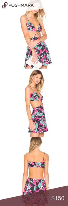 """X Naven Twins Strappy Dress NBD is a line for the young-at-heart that feature dresses that every girl covets and pieces that are sexy, flirty, fun and now. This sexy little dress features: Poly blend Hand wash cold Fully lined Waist cut-out Exposed back zipper closure Measures approx. 33"""" in length Color – Pink floral NBD Dresses Mini"""