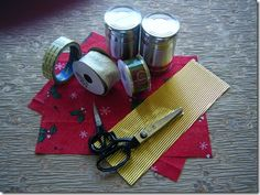 Making Christmas Crackers using recycled tin cans