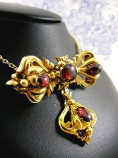"""Museum Quality Rare Early Victorian 15ct Gold Mourning Pendant with Blood Red Bohemian Garnet in the shape of a Bow. Brooch fittings and Hair Locket to the reverse. Pendant measures 2 1/4"""" inches x 1 3/4"""" inches Drop. Dates from Circa 1835 to 1840"""