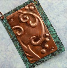 Handmade Embossed Copper Pendant Component by SunStones on Etsy, $22.00  This pendant component is made from a sheet of copper which I embossed with a scroll pattern, oxidized and polished. I then riveted it on to a patinated sheet of copper. Copper jump rings included. Ready for your embellishment or to use as is!