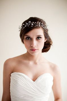 Complete bridal look against white wall
