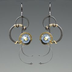 Steampunk earrings.  Luckily, I happen to have about 48# of metal parts that I've been waiting to do something with.  :)