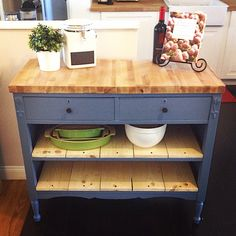 Repurposed antique dresser as a kitchen island with a butcher block top.. super cute!!