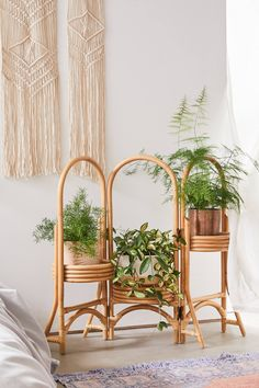 Today's decor is all about rattan—and the material is beautifully represented in this oh-so-unique plant stand. With three panels, it's a twist on a classic plant stand and the ideal way to add something green and pretty to that awkward corner. Indoor Plant Shelves, Indoor Plants, Bohemian Living, Bedroom Plants, Bedroom Decor, Rattan Planters, Farmhouse Side Table, Home Upgrades, Plant Decor