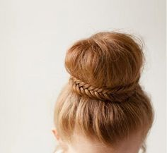classic ballerina bun with unique braided detail @myweddingdotcom