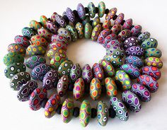 Lots of colorful beads by Silvia Ortiz de la Torre aka Madreselva61. Great eye candy!