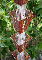 Rain Chains are way better than gutters! I'm going to start installing these for some clients, and we have our first one working at our house :)