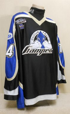 A trade brought Warren Byrne from Youngstown to Sioux Falls where he played the remainder of the season. These are the usual heavy, dazzle material like the previous seasons. Fully embroidered attached crest. Sewn-on three-color numbers and attached single color nameplate. Alternate logo patches on both shoulders. Embroidered USHL patch and manufacturer logo on front. Fight strap. Made by Gemini and is a size 52. This is the last season for this style jersey.