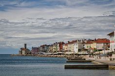 Photograph by Stuart Litoff.  #Midday in #Piran, #Slovenia, a #port #town on the the #Adriatic #Sea, with the #lighthouse #tower at the far end of the #jetty.