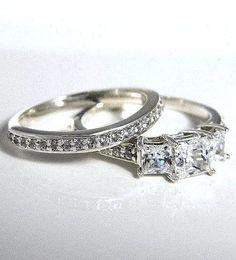 Mine.   https://www.etsy.com/listing/165409880/152-ctw-princess-cut-3-stone-accented