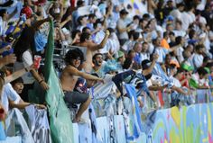 Argentine fans celebrate after Lionel Messi scored during the group F World Cup soccer match between Argentina and Iran at the Mineirao Stadium in Belo Horizonte, Brazil, Saturday, June 21, 2014. Lionel Messi scored a superb goal in stoppage time to give Argentina a 1-0 victory over Iran.