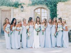 Friends, grab a coffee and gather around because this next little number isone that'll make you want to sit and stay a while. Dressed up in the softest shade of blueAmsalebridesmaids and floral pretties byTangled Lotus, it's organic elegance with