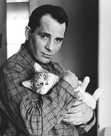 """A cat with badass Jack Kerouac. Badass credentials: Helped begin the Beat movement and became it's most popular writer. Wrote """"On the Road"""". Created improvised haiku writing. Helped Allen Ginsburg with his legendary poem """"Howl"""". Championed poet Gregory Corso. Redefined the approach to writing a novel."""