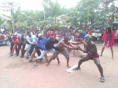 """This Akwa Ibom man said to be 77 years old performs amazing feats such as pulling a car with his teeth and eating bottles. Super Sampson The World Sampson or Super Dragon as he is called is so strong that he cannot be pulled down by 15 men. Check out photos from his show held on 29th December 2016 at his hometown; Ikot Eyo Nsit Ubium L.G.A.  """"Today I had the rare privilege to take this shot with The World Sampson Super Dragon who had gone far across the globe performing shows in major…"""