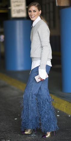 'It' girl: Olivia Palermo, 30, looked uber chic in a pair of Michael Kors feather embellished jeans during NYFW
