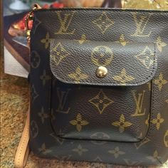 Authentic Louis Vuitton partition wristlet EUC Authentic Louis Vuitton partition wristlet  in pristine condition! Date code is no longer legible so I paid an authentication service for a letter that will come with it. You would want it for insurance purposes as well. Vachetta strap and Piping and Alcantara lining are excellent!!! Louis Vuitton Bags Clutches & Wristlets