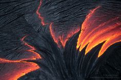Wicked Liquid - Effusion of pahoehoe from a ruptured tumulus creates an amazing abstract at its apex, as the surface of the fluid lava cools rapidly along the trailing edge. Top Photographers, Pretty Cool, Art Forms, Lava, Wicked, The Incredibles, Ocean, Fire, In This Moment