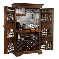 Hide-a-Bar Cabinet - Can hold 22 wine bottles along with a generous amount of room for liquor storage!