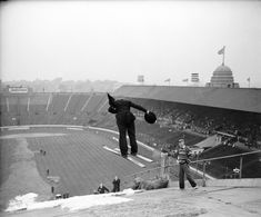 An amateur ski-jumping event is held at Wembley Stadium, 1961
