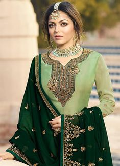Green Ethic Embroidered Pakistani Gharara Suit features a beautiful designer satin georgette top with delicate traditional embroidery with zari and resham machine work that goes amazingly with the . Pakistani Gharara, Pakistani Dress Design, Pakistani Dresses, Indian Dresses, Kurti Embroidery Design, Afghan Dresses, Designs For Dresses, Anarkali Dress, Indian Designer Wear