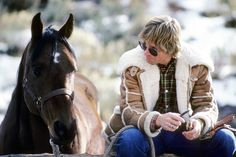 Looks like John Denver is listening to Mr. Ed the horse!
