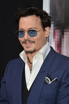 Pin for Later: Johnny Depp Wears Amber Heard's Engagement Ring on the Red Carpet!