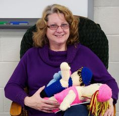 """Chesapeake native Robin Owens knows life as a military """"brat"""" can be hard - her father served for 21 years, and was often away for a year or more. That's why three years ago, Owens, 54, started the Dabby Project, which sends a crocheted doll to be the companion of children of deployed service members."""