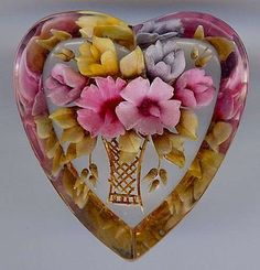 VINTAGE REVERSE CARVED PAINTED FLOWER BASKET LUCITE HEART PIN