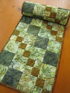 This table runner was made using batik fabrics. The colors worked so well together. Display this runner on your table to enhance your decor. This table runner would make a wonderful gift. This table r Patchwork Table Runner, Table Runner And Placemats, Table Runner Pattern, Quilted Table Runners, Batik Quilts, Lap Quilts, Small Quilts, Place Mats Quilted, Quilted Table Toppers
