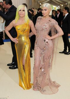 Dressed by the best: Kylie posed with designer Donatella Versace as the pair arrived at th...