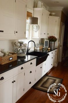What I want!!! White cabinets, black sink and countertops to go w/ my black appliances... STONEGABLE FALL HOUSE TOUR