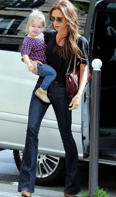Stylish mums: Victoria Beckham   Former Posh Spice works the wide leg jeans with minimal styling and a pretty gorgeous accessory.