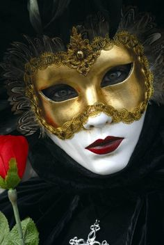 Although this mask is quite plain with its design (compared to other venetian masks), i love the feathers and gold theme alonside the white base and strong lips.