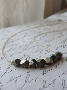Got a few beads from a broken necklace or leftovers...make a simple, stylish necklace!