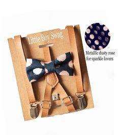 This classic and elegant metallic dusty rose & navy polka dot bow tie is paired with tan beige leather suspenders and is sure to be a show stopper.. From newborn to teens, you'll have to set aside some extra time to be stopped and complimented all night long! If its a rustic barn country wedding to attend (or sneak into), ring bearer or birthday boy to dress up, cake smash to smash or family photo to take, show up in style! #littleboyswag #wedding #ringbearer #weddinginspiration…