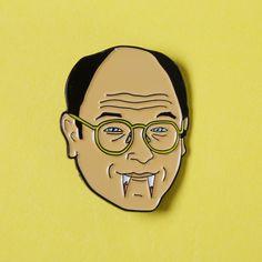George Costanza soft enamel pin.   Turn you favourite sitcom stars into wearable art.