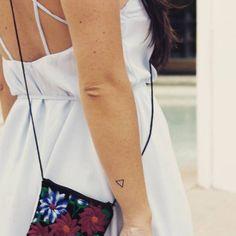 Triangle tattoo on Marina.