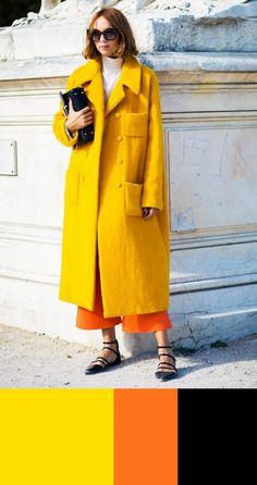 Candela Novembre wears a white turtleneck, yellow coat, orange culottes, and black flats