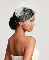 """Birdcage Veil - This dreamy mesh veil reveals your beauty with a fanciful birdcage design, anchored with a brilliant assortment of sparkling crystals. Includes attached hair comb for easy styling. 12"""" from hair comb to veil at longest point.         Items in our Weddings & Events Collection can only be exchanged or returned by mail."""