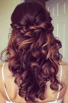 Half up half down hair with braid with loose bouncy curls on long hair