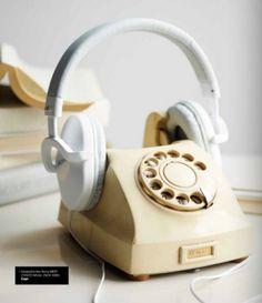 old phone used as headphone storage