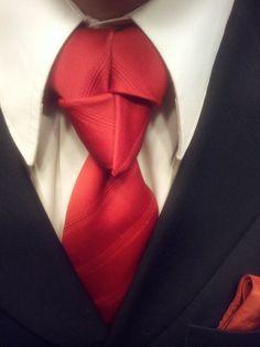 The Truelove Knot man's neck-tie. I don't know why I love to see a man self assured to be creative with his ties.