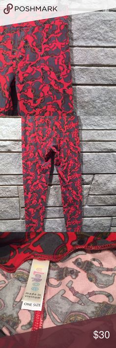 LuLaRoe red cat leggings Egyptian sphinx NWOT LuLaRoe red Egyptian Sphinx looking cat leggings.  Size: One size Condition: New without tags. Smoke free home.  I have another pair of LuLaRoe cat leggings for sale - please check out my closet and bundle for extra savings!  Feel free to ask any questions. Bundle for special offers! LuLaRoe Pants Leggings