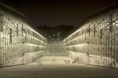 The EWHA Woman's University by Dominique Perrault Architecture is a unique campus formed between two buildings that create a canyon within the Seoul topped with green roof gardens. University Architecture, Architecture Awards, Facade Architecture, Sustainable Architecture, Landscape Architecture, Night Scenery, Green Facade, Facade Lighting, Berlin